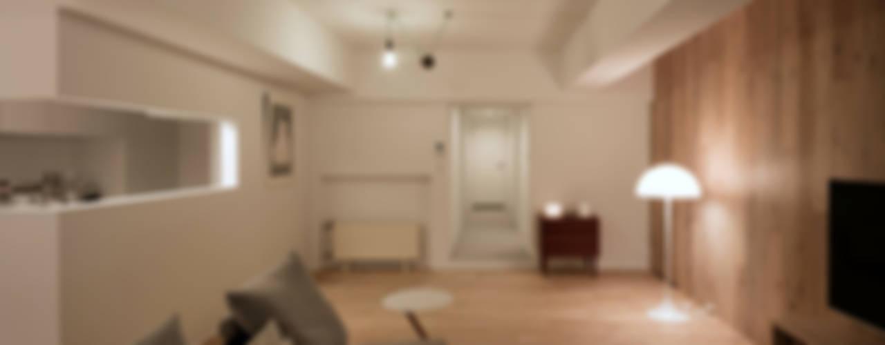 ห้องนั่งเล่น by 一色玲児 建築設計事務所 / ISSHIKI REIJI ARCHITECTS