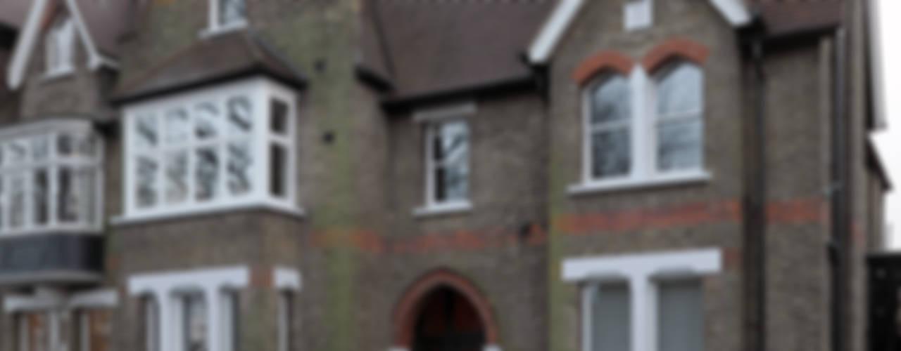 Shepherds Hill Nowoczesne domy od Inglis Badrashi Loddo Nowoczesny