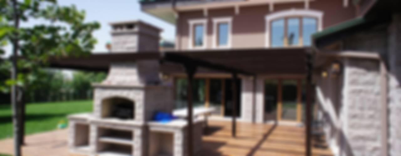 Casas de estilo  por RETA Architecture-Interior-Industrial Design