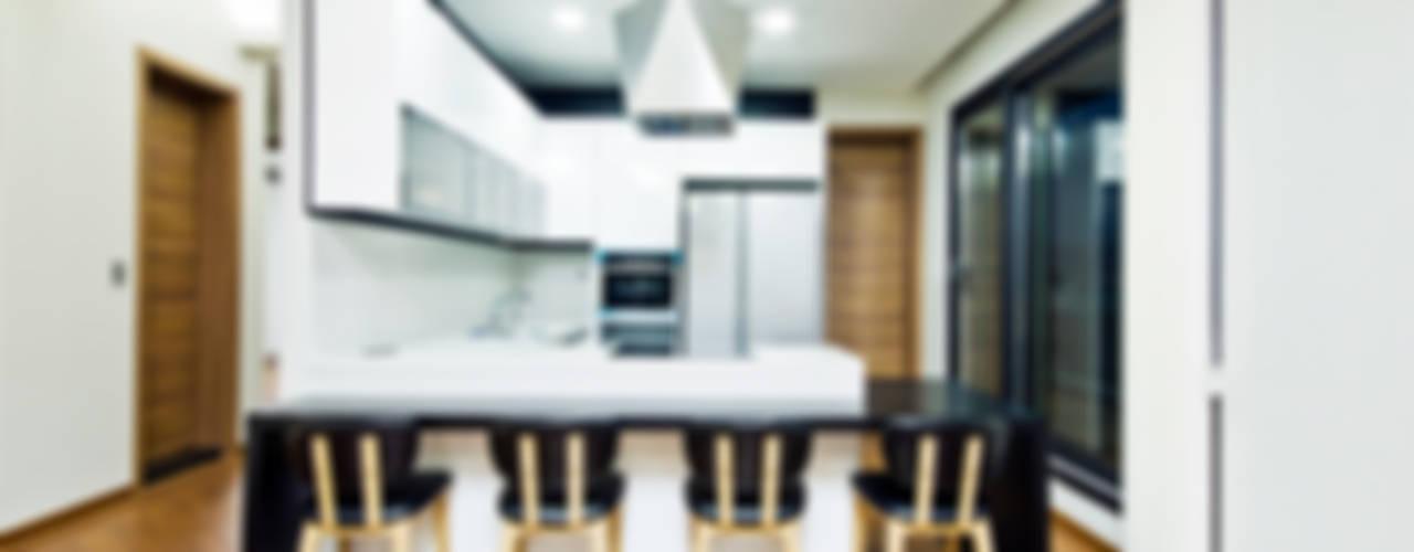구산동 근린생활시설+주택: GongGam Urban Architecture & Construction의  다이닝 룸