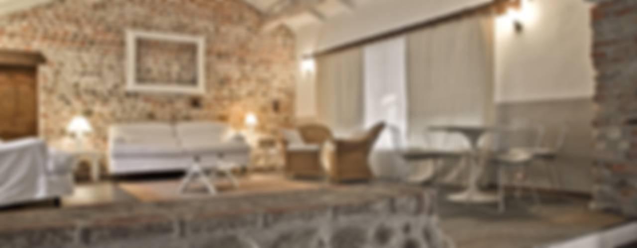 Salas / recibidores de estilo  por Fabio Carria