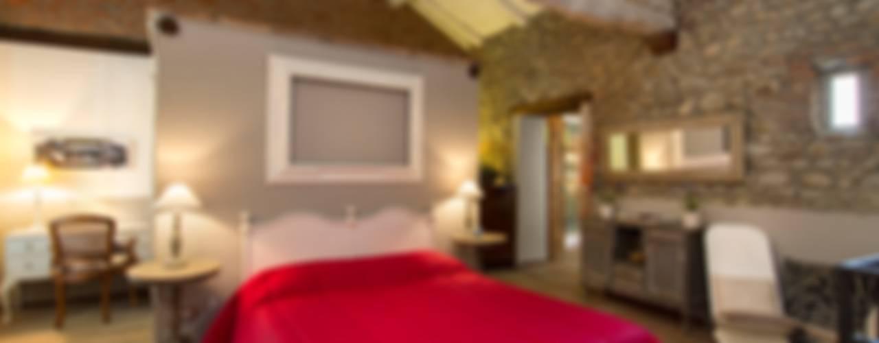 Dormitorios de estilo  por Fabio Carria