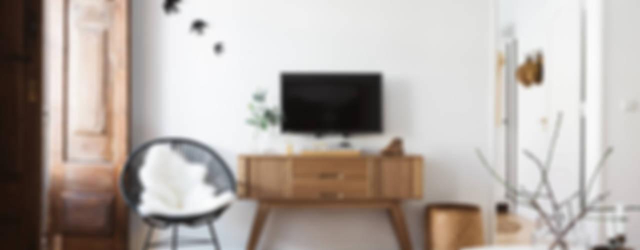 Remodelação de apartamento: Salas de estar  por Architect Your Home