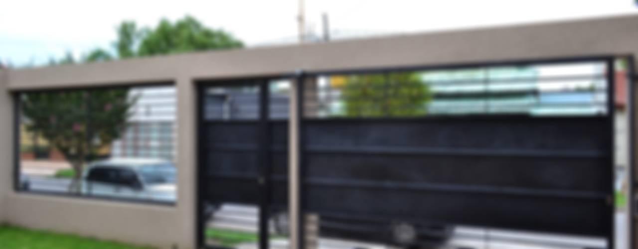 Garajes y galpones de estilo  por epb arquitectura