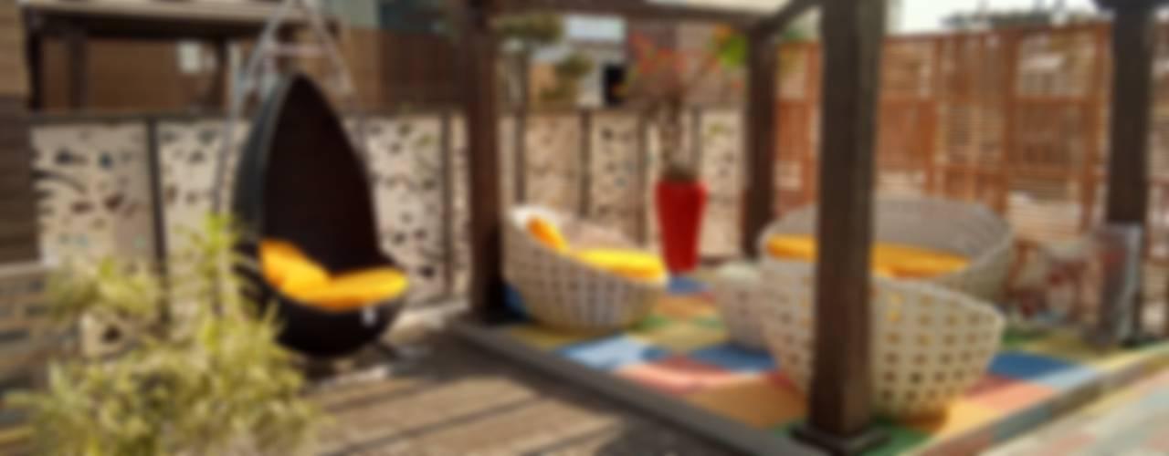 Modern Terrace by DG DESIGNER LANDSCAPES LLP Modern