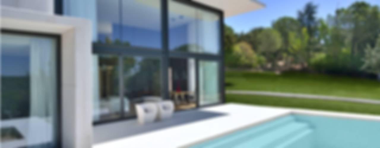 Projekty, nowoczesne Domy zaprojektowane przez MODULAR HOME