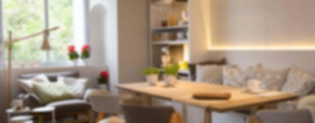 Sala da pranzo in stile in stile Moderno di Estudio de iluminación Giuliana Nieva
