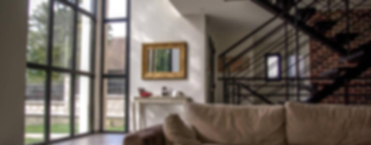 Salas de estar minimalistas por Daniel architectes Minimalista