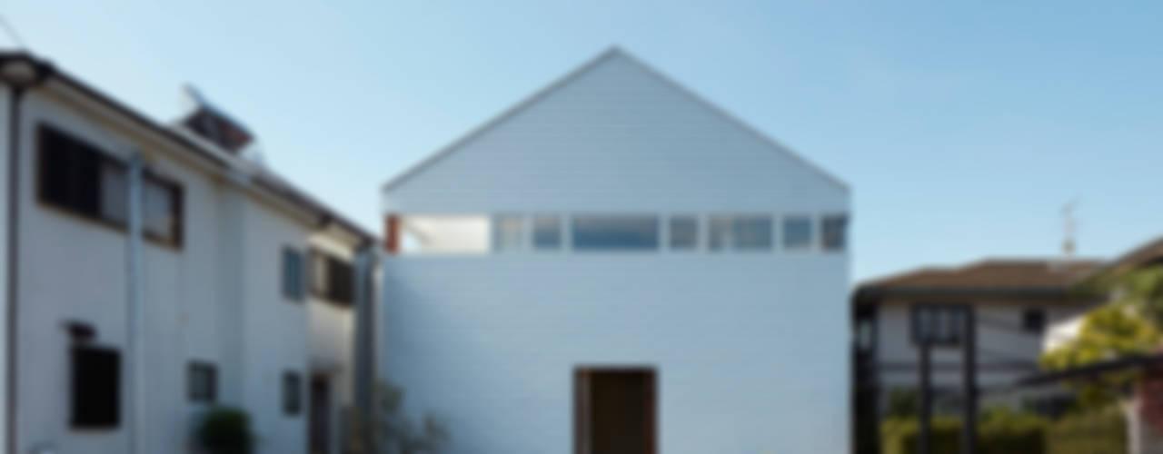 Minimalist houses by 小泉設計室 Minimalist