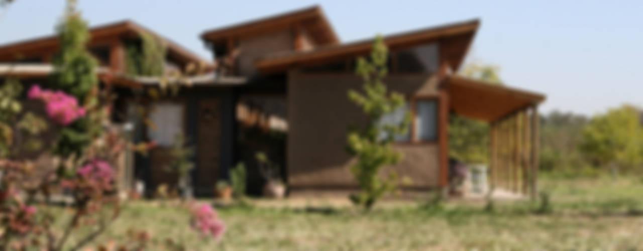 Casas unifamiliares de estilo  por ALIWEN arquitectura & construcción sustentable - Santiago