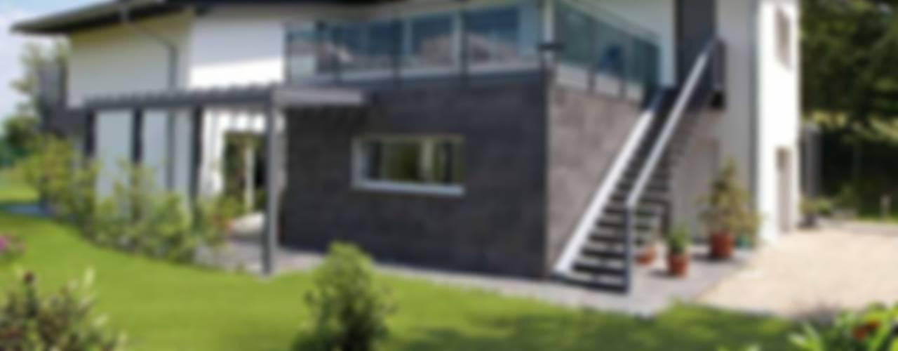 Casas de estilo moderno por Spazio Positivo