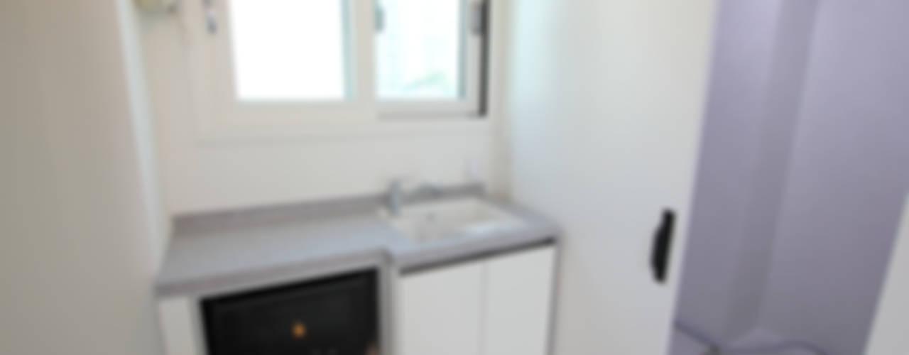 관평동 테크노밸리 10단지 꿈에그린아파트 34평형 모던스타일 발코니, 베란다 & 테라스 by 더홈인테리어 모던