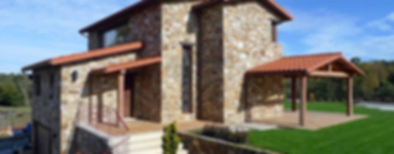 Case in stile in stile Rustico di AD+ arquitectura