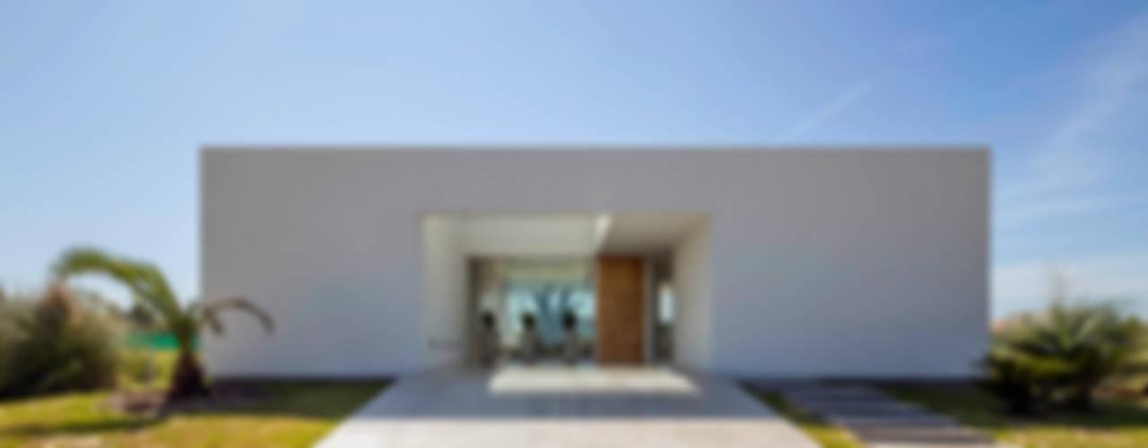 Casas minimalistas de VISMARACORSI ARQUITECTOS Minimalista