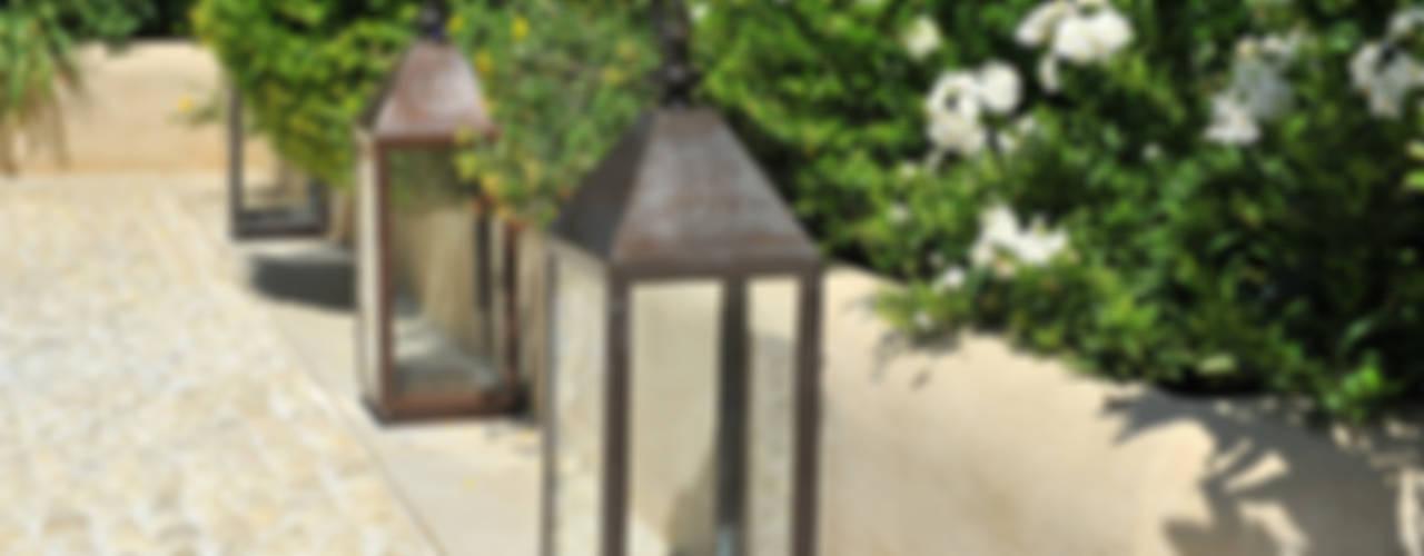Cura dei dettagli:  in stile  di Giardini Giordani
