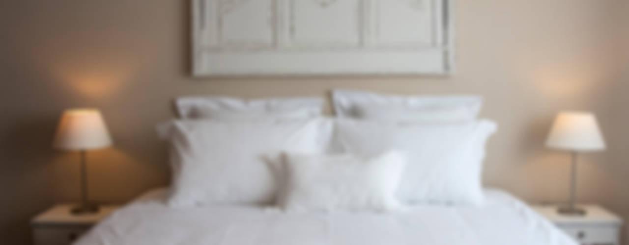 Dormitorios de estilo  por alma portuguesa