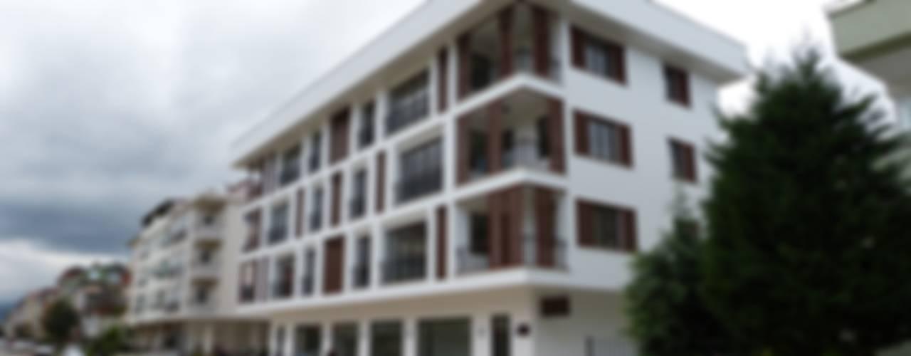 yücel partners – Lavinya Apartmanı: modern tarz Evler