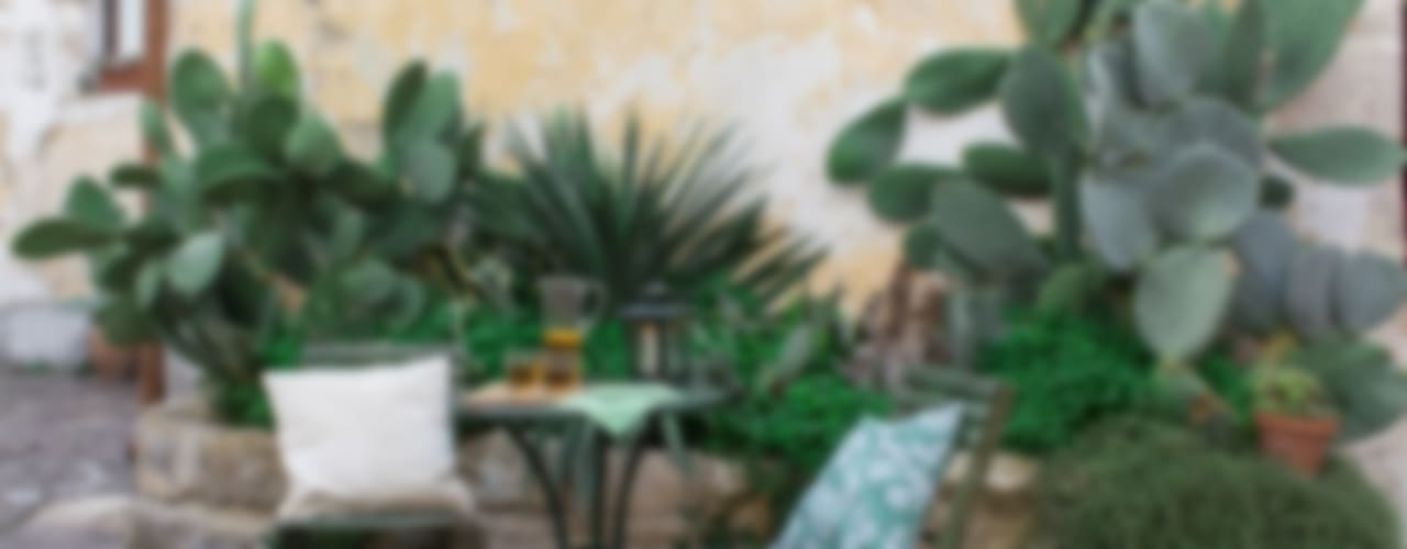 Jardines de estilo mediterraneo por Boite Maison