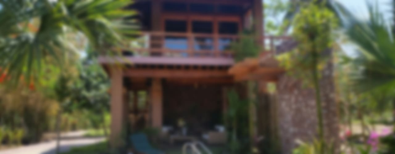 BUNGALOW PAPIRO Cervantes Bueno arquitectura Jardines rústicos Piedra Acabado en madera