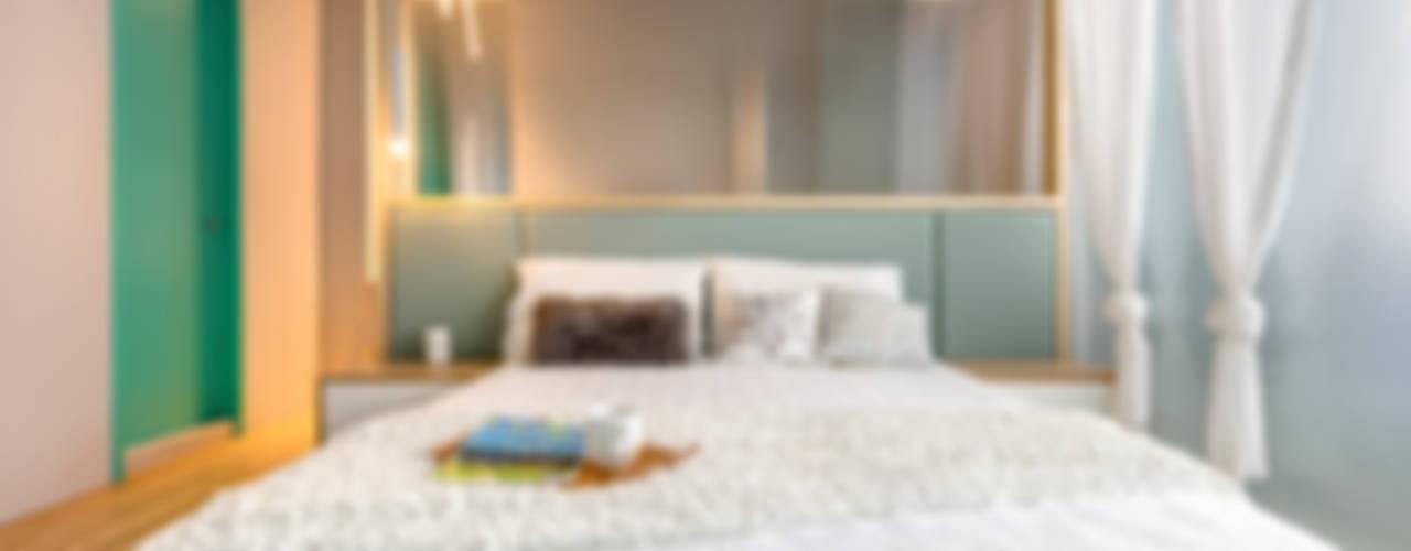 Dormitorios de estilo ecléctico de 磨設計 Ecléctico