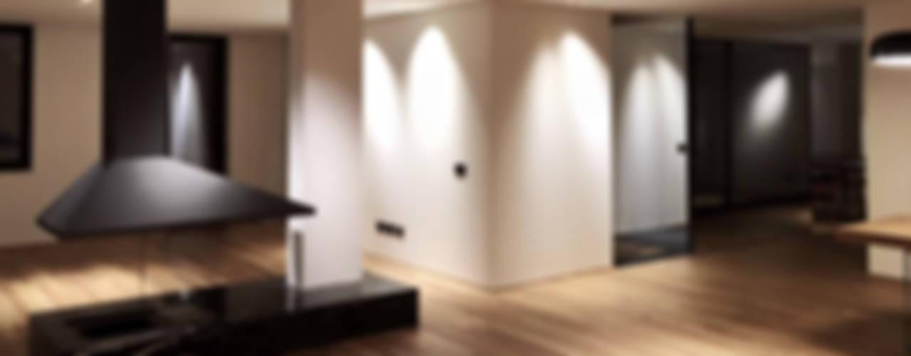 Salas / recibidores de estilo  por MM A | Massimiliano Masellis Architetti