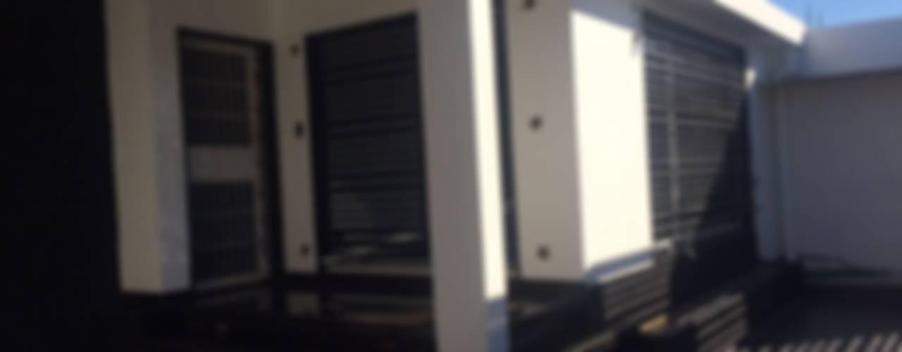 Remodelación/Ampliación Vivienda Villa Acropolis: Casas de estilo  por Arq. Alberto Quero