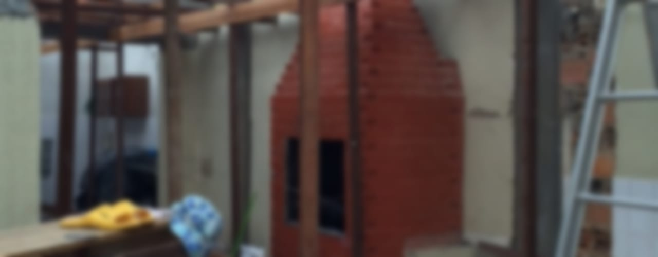 Garajes rústicos de Reinaldo Pampolha Arquitetura Rústico