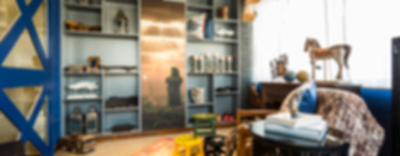 PEACOCK LIFE SHOWROOM:  Living room by Turiya Lifestyle LLP