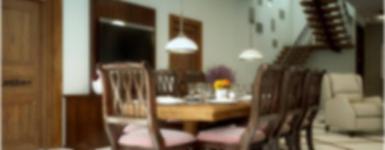 Grand & Striking:  Dining room by Premdas Krishna