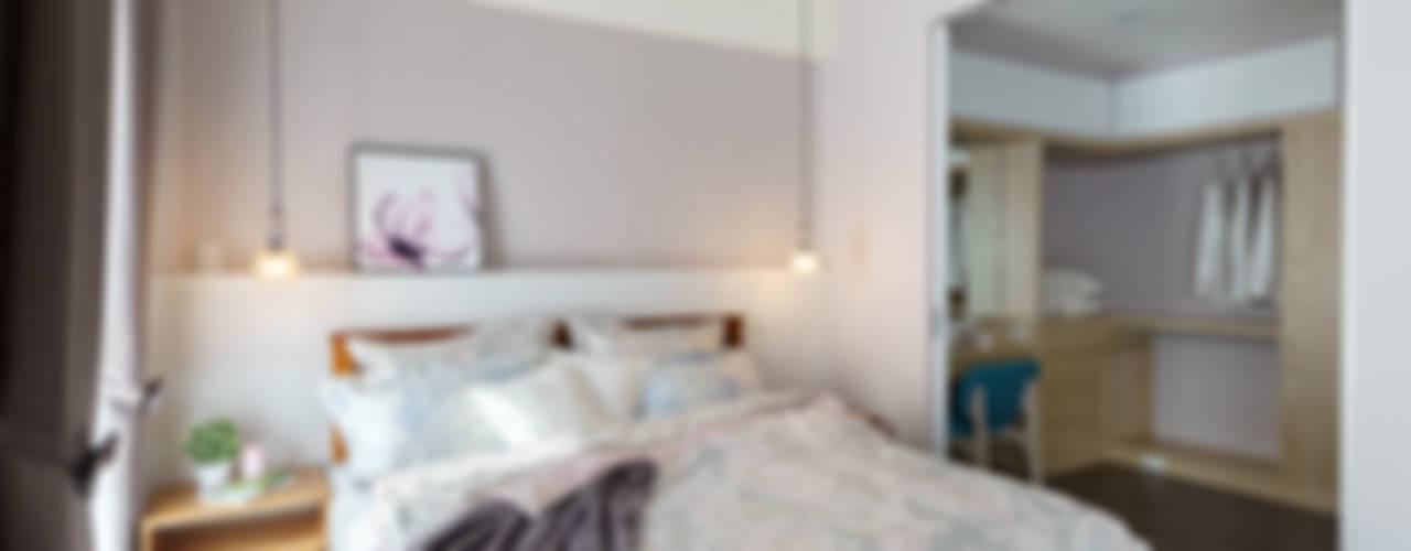 Dormitorios de estilo ecléctico por 橡樹設計Oak Design