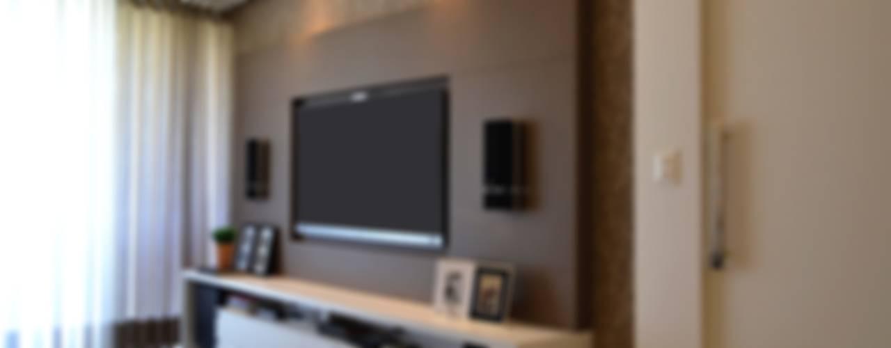 Salas de estar modernas por Join Arquitetura e Interiores