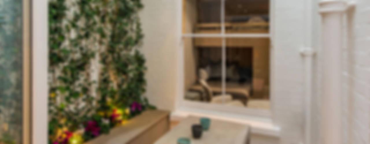Jardines de invierno de estilo minimalista por Maxmar Construction LTD