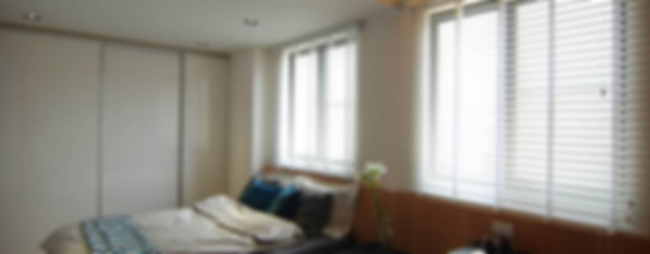 Dormitorios de estilo  de 一穰設計_EO design studio,