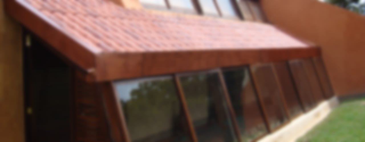 CASA TERRACOTA: Casas campestres de estilo  por CUNA ARQUITECTURA INGENIERÍA SOSTENIBLE