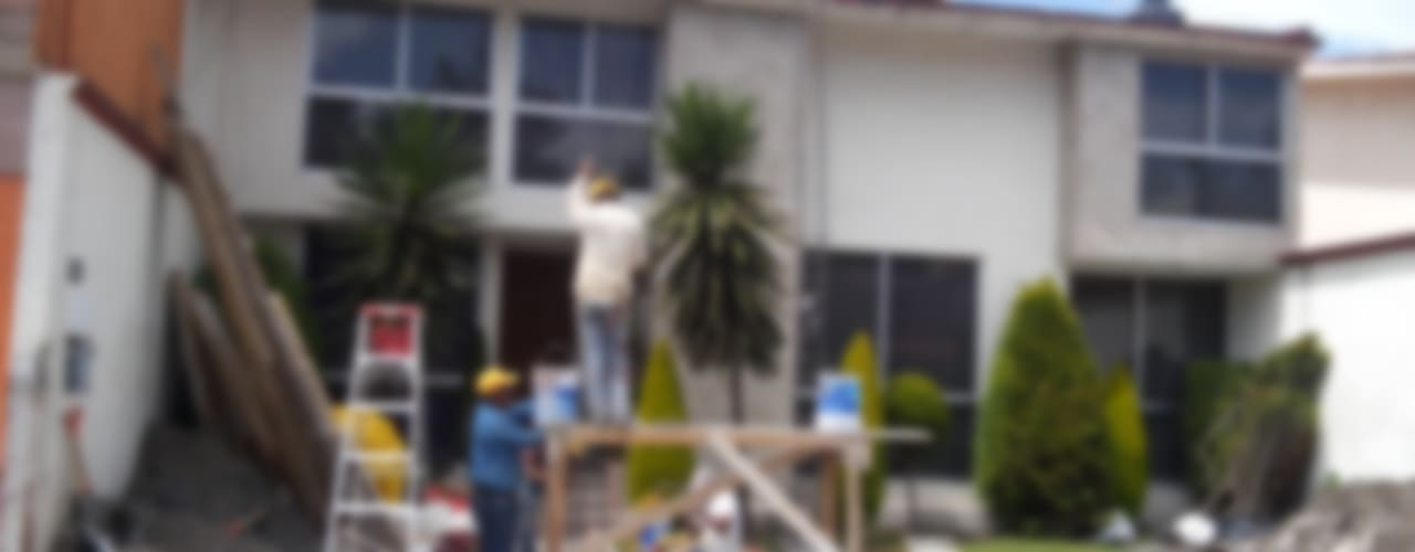 Fachada principal de casa San Carlos: Casas unifamiliares de estilo  por Arkisav