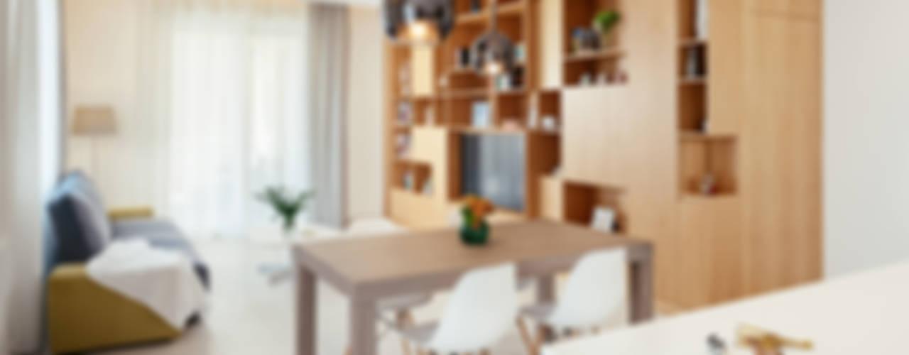 Zona living: Soggiorno in stile  di manuarino architettura design comunicazione