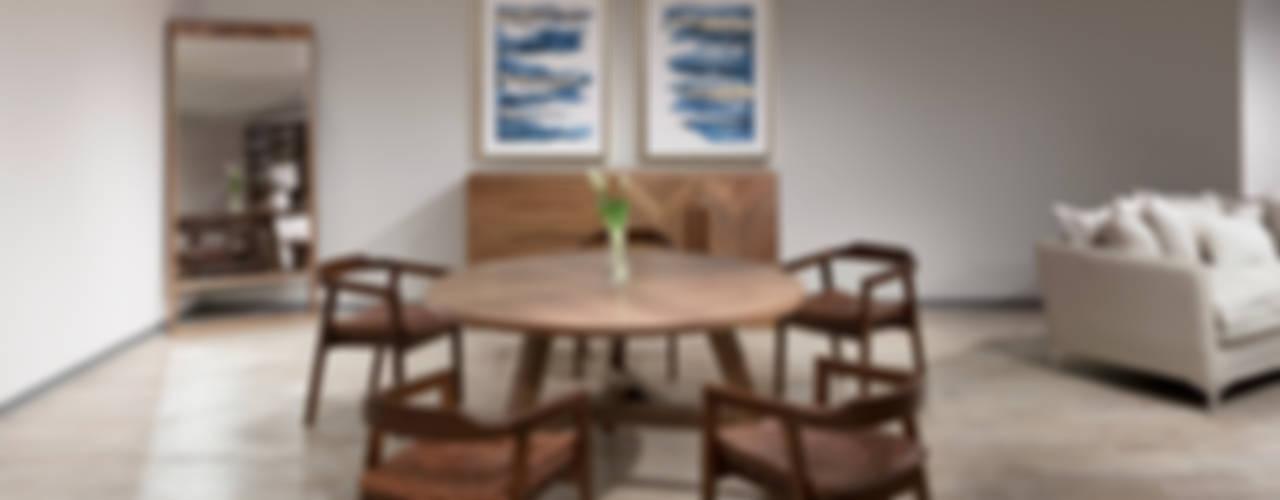 Colección de comedores redondos de Casa de las Lomas Moderno