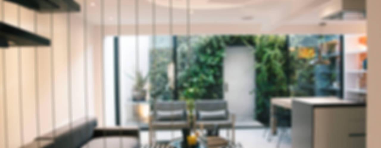 CHAVARRO ARQUITECTURA Salones de estilo moderno Hormigón Blanco