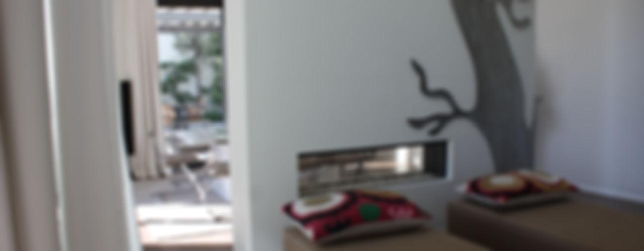 CHIMENEAS UNICAS CHIMENEASAML Salones de estilo moderno