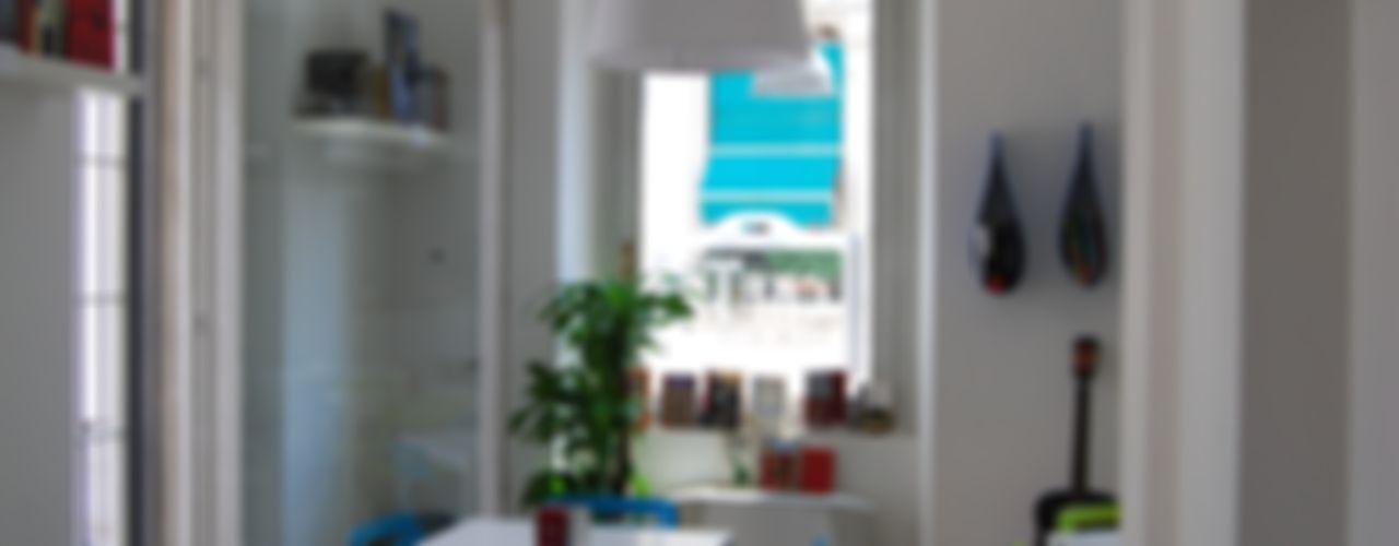 Gogol'ostello con cafTè letterario atelier architettura Negozi & Locali commerciali in stile eclettico