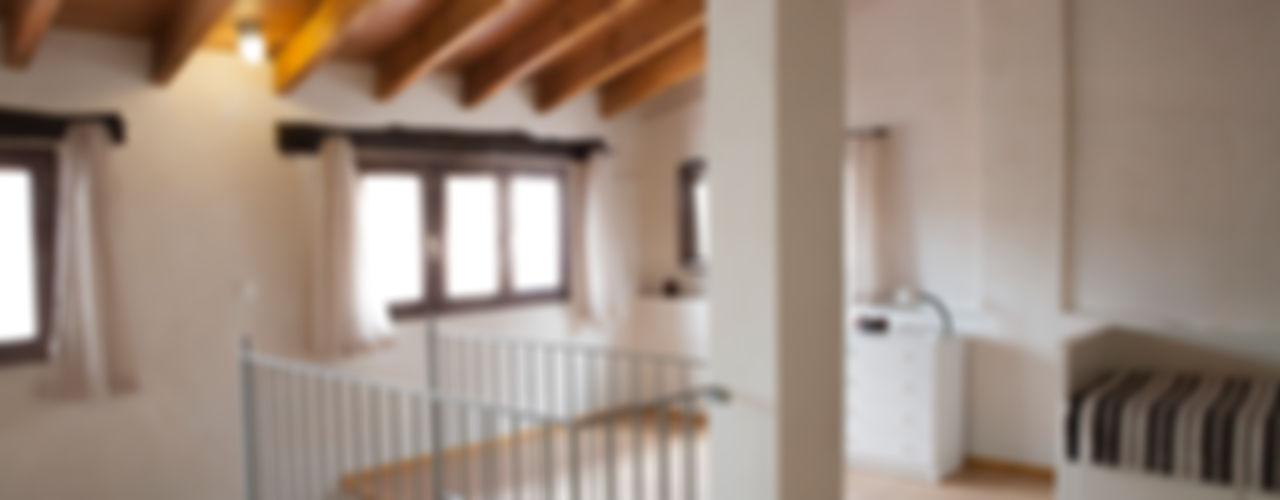 La casa de Karen FGMarquitecto Salones rústicos de estilo rústico