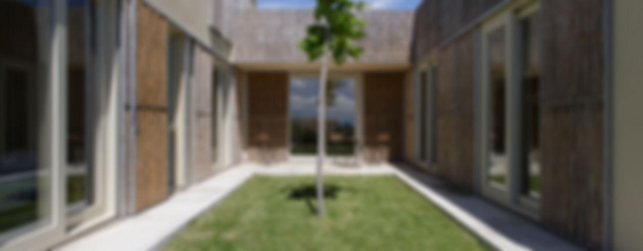 b-House Case moderne Legno Effetto legno