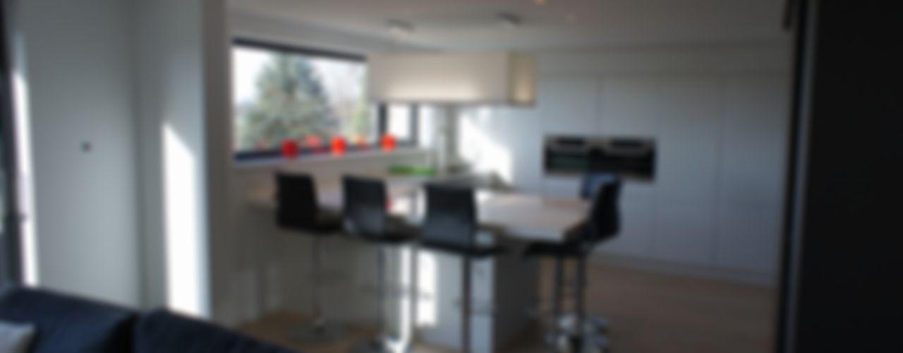 Maison passive en ossature bois Bureau d'Architectes Desmedt Purnelle CuisineTables, chaises & bancs