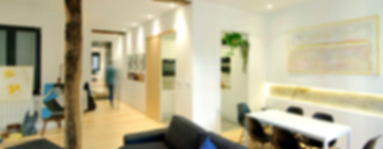Reforma vivienda Garmendia Cordero arquitectos Salones de estilo moderno