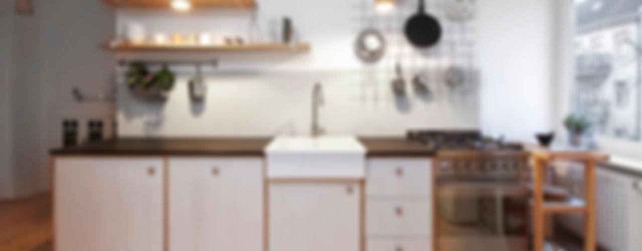 Happyhomes Cocinas minimalistas Madera Gris