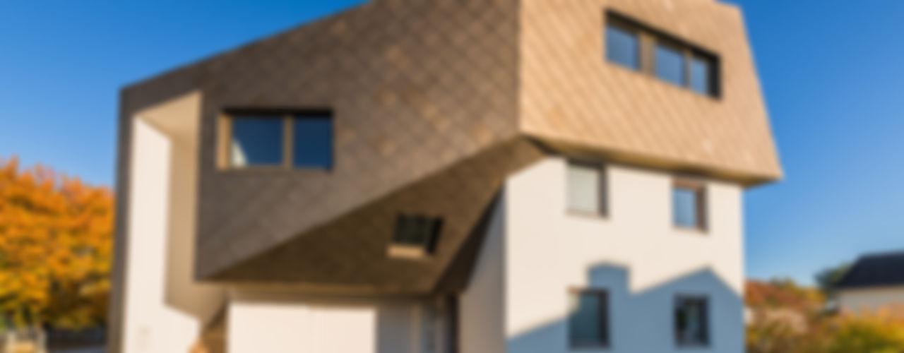 Dachaufstockung für ein Architekturbüro Helwig Haus und Raum Planungs GmbH Ausgefallene Häuser