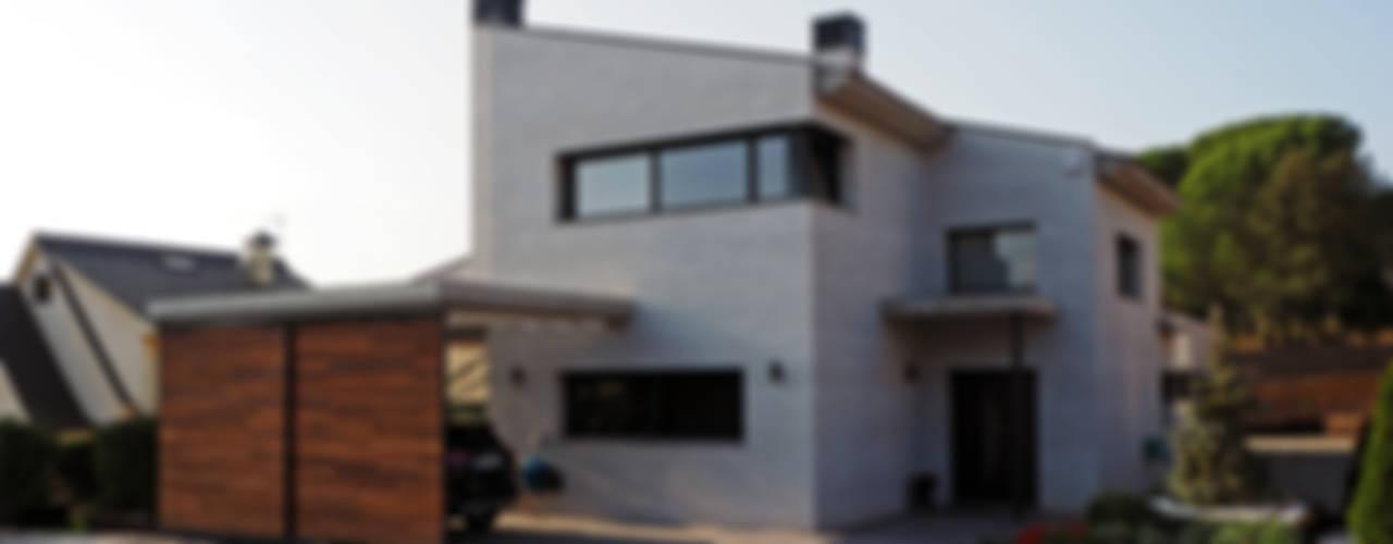 Casas de estilo moderno por Atres Arquitectes