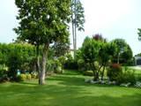 Progettazione giardino privato a Botticino (BS): Giardino in stile in stile Moderno di Quartiere Fiorito