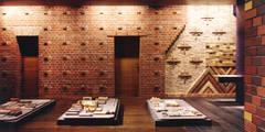 煉瓦との出会い: ユミラ建築設計室が手掛けた壁&フローリングです。