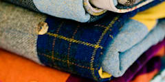 A stack of Finest Harris Tweed quilts:   by Quilts by Lisa Watson